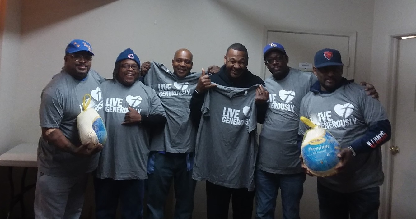photo of men helping with the food pantry distribution