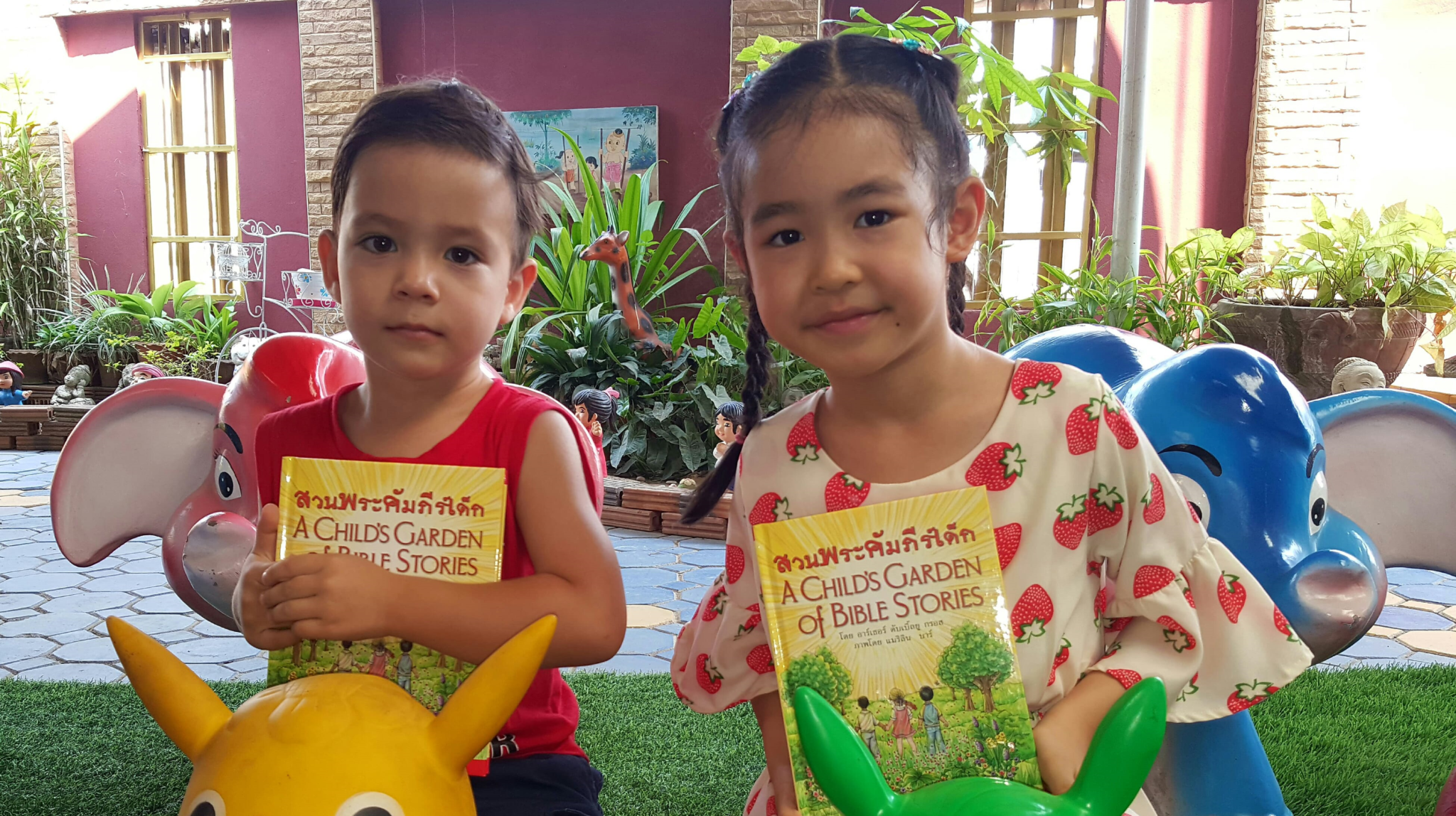 2 Asian children with new books