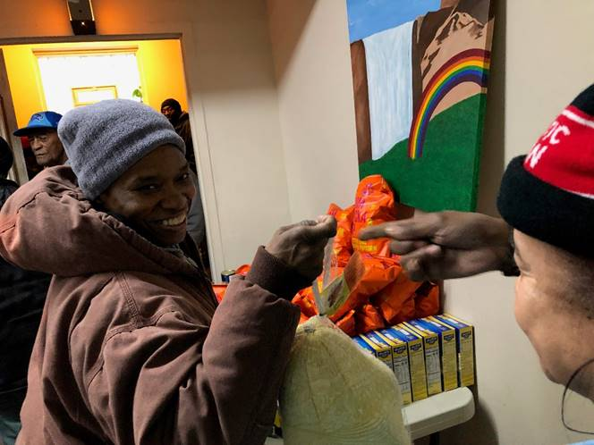 A photo of 2 women at the Zion Food Pantry in Chicago, IL.